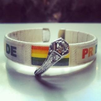 pride bracelet and engagement ring.